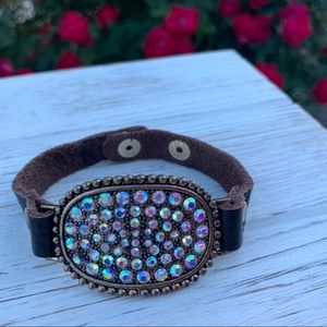 Faux bracelet with multi colored rhinestones